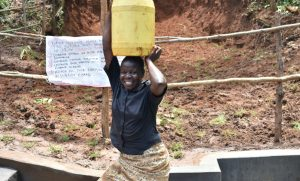 The Water Project:  Mounting Water Is Easier On Level Access Area