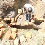 The Water Project: Emusaka Community, Muluinga Spring -  Construction Of Headwall And Wing Wall