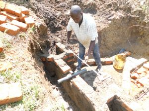 The Water Project:  Setting The Pipe