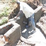 The Water Project: Emusaka Community, Muluinga Spring -  Plastering The Walls