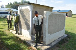 The Water Project:  Posing At The Back Of Latrines And Urinal