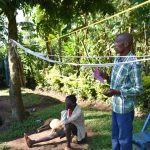 The Water Project: Emusaka Community, Muluinga Spring -  A Community Member Contributes A Point