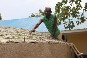 The Water Project:  Artisan Inspecting The Dome Form Before Casting