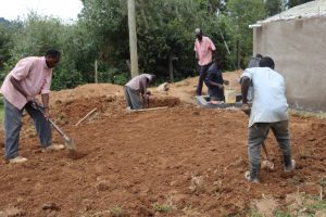 The Water Project:  Leveling Ground Around Tank