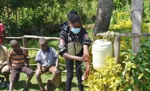 The Water Project:  Trainer Elvine Demonstrates Handwashing