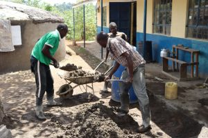 The Water Project:  Loading Sand And Cement Mixture