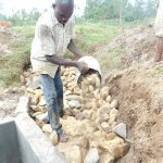 The Water Project: Emusaka Community, Muluinga Spring -  Layer Of Smaller Stones