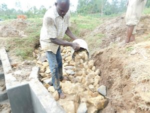 The Water Project:  Layer Of Smaller Stones