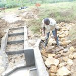 The Water Project: Emusaka Community, Muluinga Spring -  Backfilling In Progress