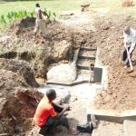 The Water Project: Emusaka Community, Muluinga Spring -  Backfilling With Soil
