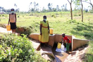 The Water Project:  Sarah Fetches Water With Her Kids