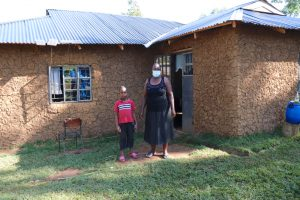 The Water Project:  Felistus With Her Son Outside Their Home