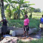 The Water Project: Mukhangu Community, Okumu Spring -  Felistus With Others At The Spring