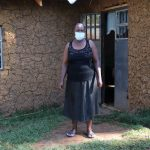 The Water Project: Mukhangu Community, Okumu Spring -  Felistus Outside Her Home