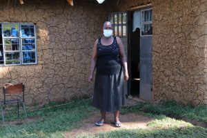 The Water Project:  Felistus Outside Her Home