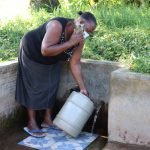 The Water Project: Mukhangu Community, Okumu Spring -  Fetching Water At The Spring