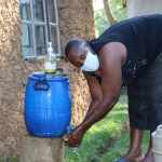 The Water Project: Mukhangu Community, Okumu Spring -  Washing Her Hands