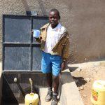 The Water Project: Jamulongoji Primary School -  Brian At The Rain Tank
