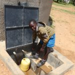 The Water Project: Jamulongoji Primary School -  Brian Fetching Water