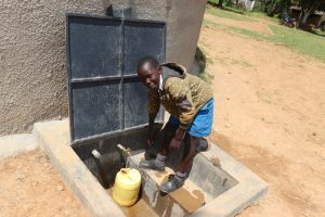 The Water Project:  Brian Fetching Water