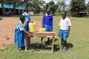 The Water Project:  Demonstrating Handwashing Station Use