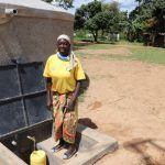 The Water Project: Jamulongoji Primary School -  Ebby Collecting Water