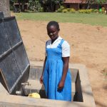 The Water Project: Jamulongoji Primary School -  Sharon Collecting Water