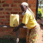 The Water Project: Jamulongoji Primary School -  School Cook Demonstrates Handwashing