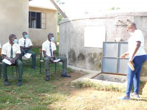 The Water Project:  Trainer Jacky Leads Site Management At The Rain Tank