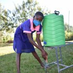 The Water Project: Eshimuli Primary School -  Students Washing Hands