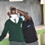 The Water Project: Makunga Secondary School -  Trainer Joyce Shows The Correct Way To Put On A Mask
