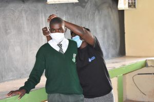 The Water Project:  Trainer Joyce Shows The Correct Way To Put On A Mask