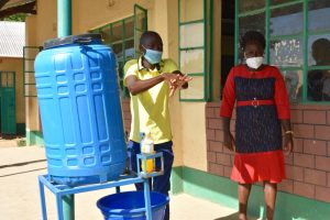 The Water Project:  Trainer Protus Shows Handwashing