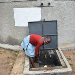 The Water Project: Isango Primary School -  A Student Fetching Water