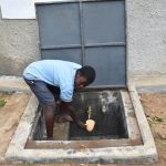 The Water Project: Isango Primary School -  A Student Gets A Drink