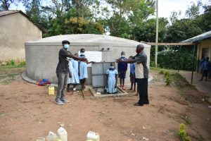 The Water Project:  Field Officer Julius Hands Over The Tank To The School