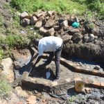 The Water Project: Bukalama Community, Wanzetse Spring -  Artisan Measures The Headwall