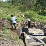 The Water Project: Bukalama Community, Wanzetse Spring -  Backfilling With Soil