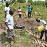 The Water Project: Bukalama Community, Wanzetse Spring -  Layering Smaller Stones