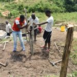 The Water Project: Bukalama Community, Wanzetse Spring -  Setting Up The Protective Fence