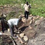 The Water Project: Bukalama Community, Wanzetse Spring -  Stone Pitching To Make Rub Walls