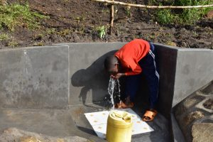 The Water Project:  A Child Drinking Water From The Spring