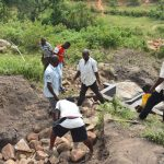 The Water Project: Bukalama Community, Wanzetse Spring -  Backfilling With Large Rocks