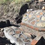 The Water Project: Bukalama Community, Wanzetse Spring -  Plastered Stone Pitching