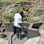 The Water Project: Bukalama Community, Wanzetse Spring -  Plastering Spring Walls