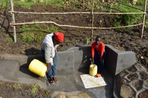 The Water Project:  Rinsing The Stairs And Collecting Water