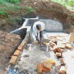 The Water Project: Mukhweso Community, Shemema Spring -  Building The Stairs