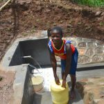 The Water Project: Mukhweso Community, Shemema Spring -  Esther At The Spring