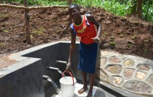 The Water Project:  Esther Gives Thumbs Up At The Spring