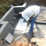 The Water Project: Mukhweso Community, Shemema Spring -  Fitting The Tiles